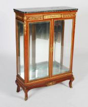 A late 19th century French satinwood and gilt metal mounted side cabinet, the mottled black, white