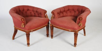 A pair of late 19th century horseshoe back conversation chairs, the button down upholstered backs