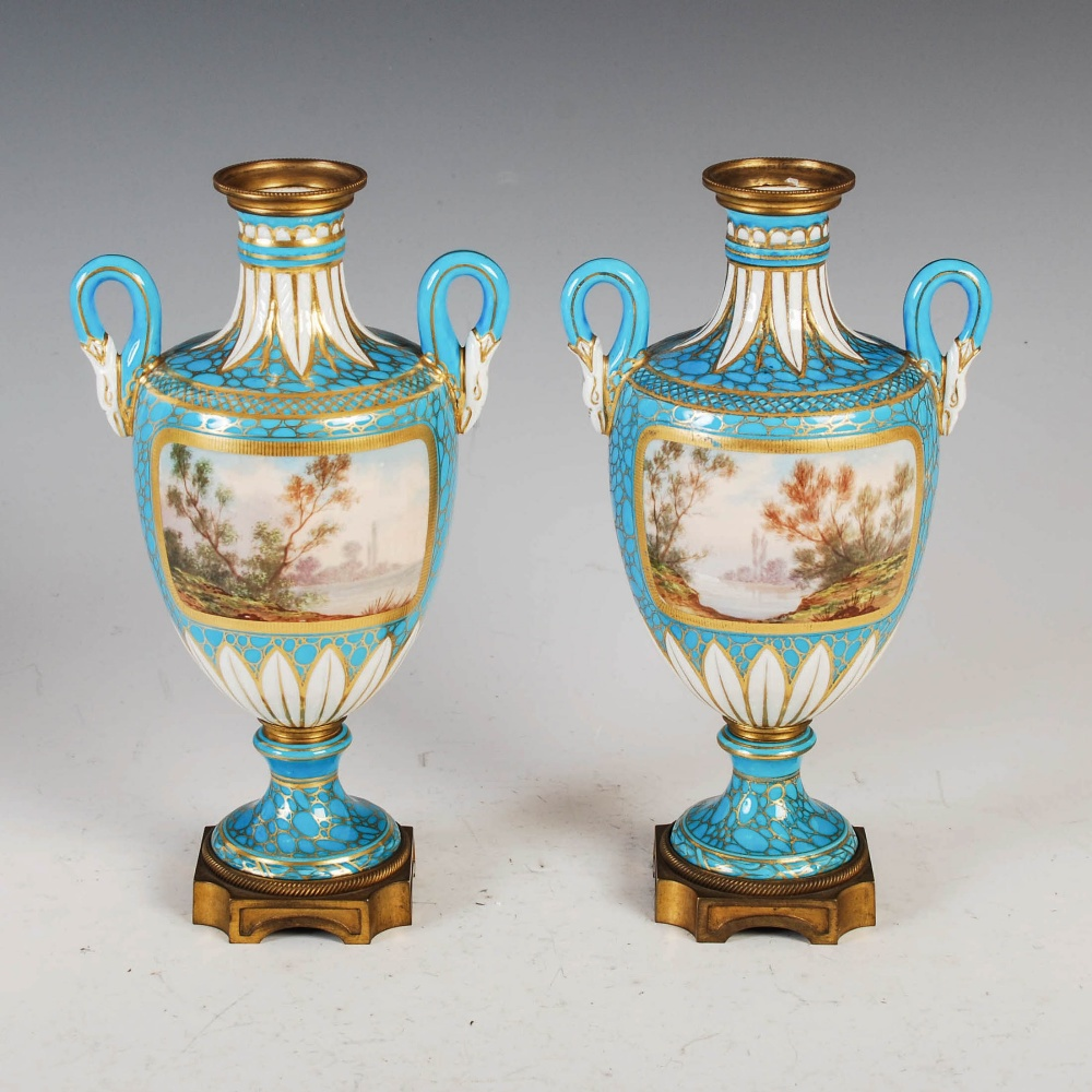 A pair of 19th century French porcelain ormolu mounted twin handled urns, decorated with hand - Image 2 of 6