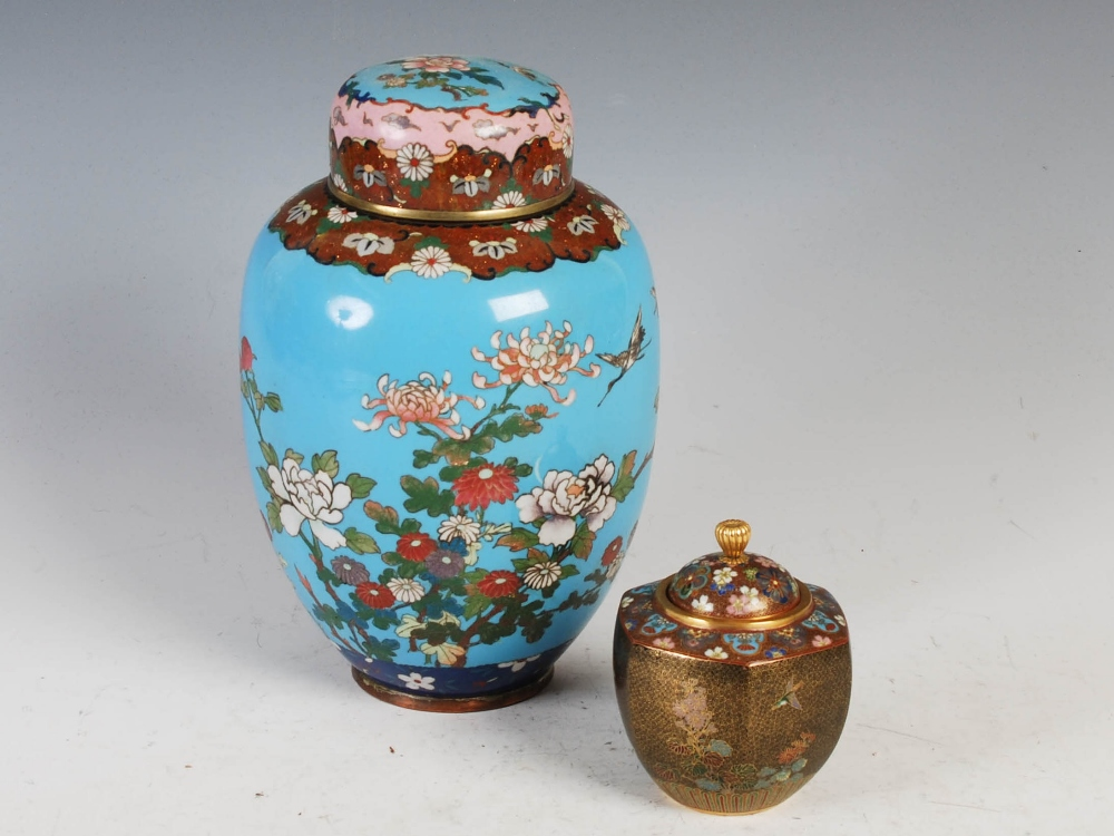 Two Japanese cloisonne jars and covers, Meiji Period, comprising a blue ground jar and two covers