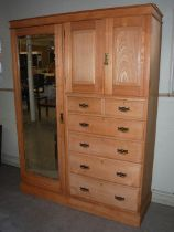 A Victorian pine wardrobe, the plain cornice over a rectangular bevelled mirror door flanked by a