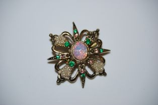 A COSTUME JEWELLERY BROOCH CENTRED WITH OVAL CABOUCHON OPAL