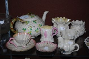 COLLECTION OF BELLEEK IRISH PORCELAIN TO INCLUDE A SHAMROCK DECORATED TEAPOT AND COVER, SHELL SHAPED