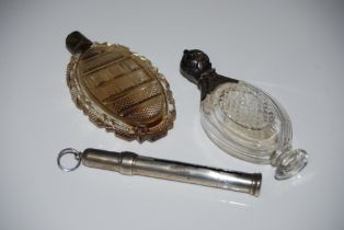 A WHITE METAL MOUNTED CLEAR GLASS PERFUME BOTTLE, ANOTHER WHITE METAL MOUNTED CUT GLASS FLASK AND