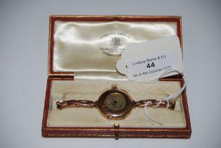 A 9CT GOLD WRISTWATCH IN ORIGINAL LEATHER BOX