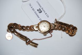 A 9CT GOLD CASED LADIES ACURIS WRISTWATCH WITH 9CT GOLD BRACELET, GROSS WEIGHT 12.1 GRAMS