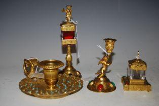 A 19TH CENTURY GILT METAL MALACHITE AND RED CABOCHON SET THREE PIECE DESK SET COMPRISING CHERUB FORM