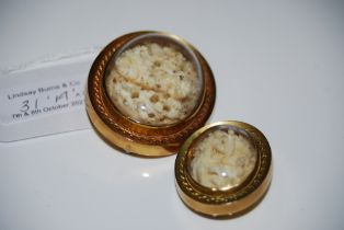 TWO LATE VICTORIAN YELLOW METAL CASED OVAL IVORY BROOCHES