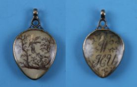 Early 18C silkworked locket depicting birds & monogram