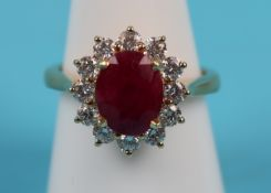 Fine 18ct ruby & diamond cluster ring