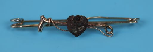 Antique gold riding crop heart brooch