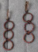 Pair of triple loop diamond & red stone earrings