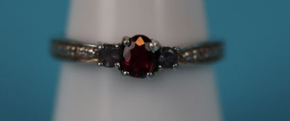White gold ruby set ring