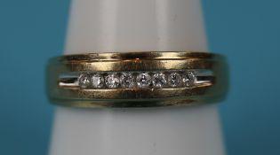 Gold channel set diamond ring