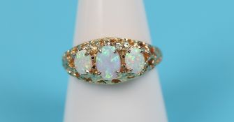 Gold opal 3 stone ring