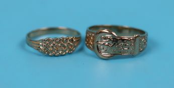 Gold buckle ring together with a gold knot ring