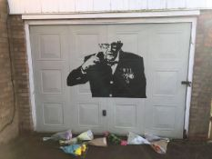 Sir Tom Moore, painted on garage door during 1st lockdown by local artists Daryl and Claire....