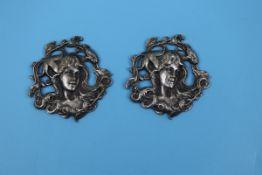 2 white metal Art Deco pendants