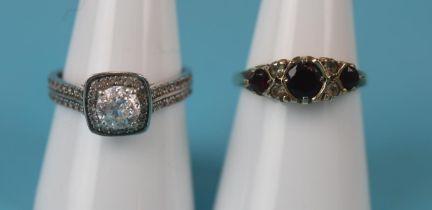 2 gold stone set rings