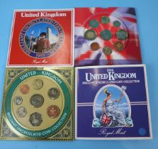 4 sets of uncirculated coins in original Royal Mint packs - 1984,1985,1999,2001