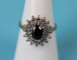 Gold sapphire diamond cluster ring