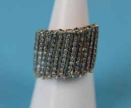 Large gold diamond encrusted ring