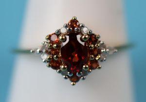 Gold garnet & diamond set ring