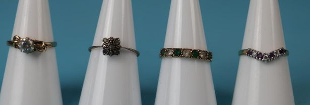 4 gold stone set rings