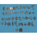 Large collection of white metal charms