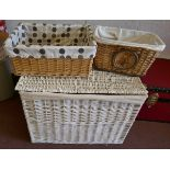White wicker laundry basket and contents
