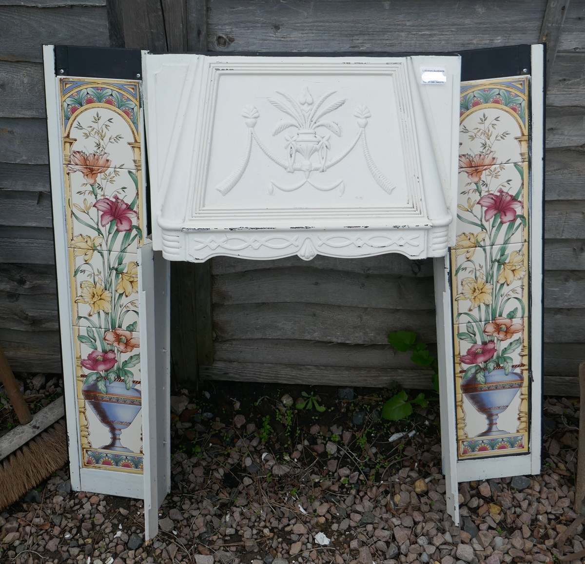 Tiled fireplace with cast iron hood
