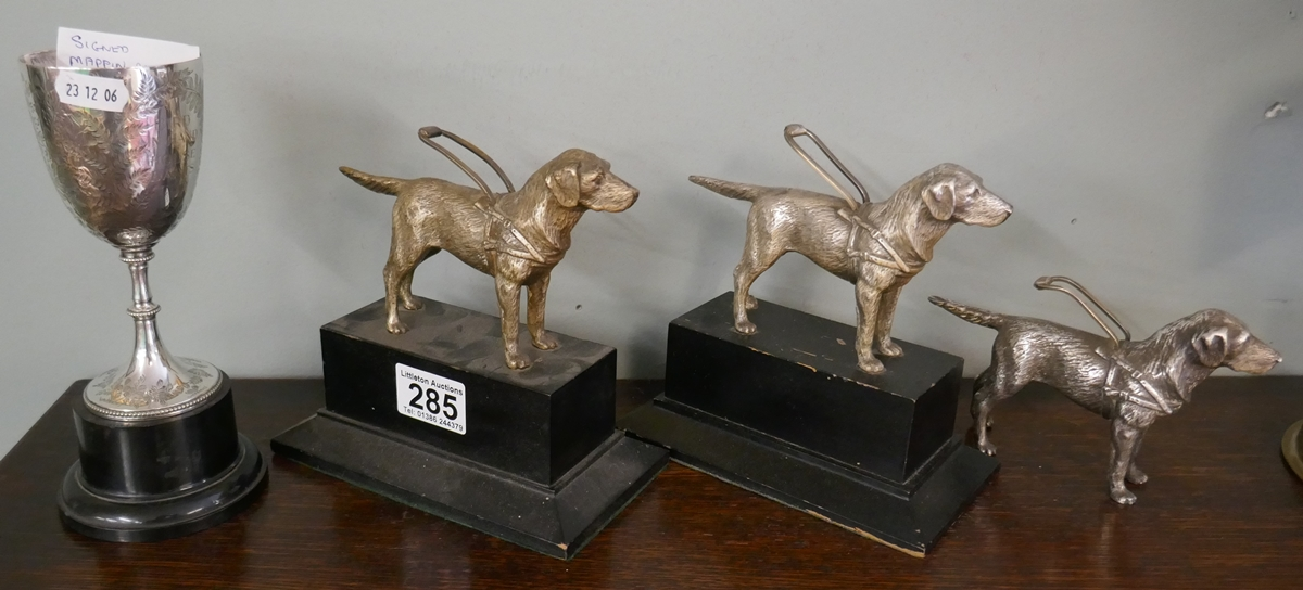 3 white metal guide dog figures & Mappin & Webb cup