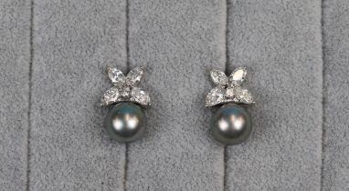 Fine pair of 18ct white gold black pearl & diamond earrings