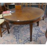 Round mahogany Georgian style table on square tapered legs