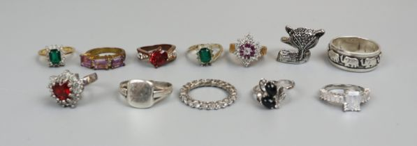 Collection of 12 rings to include silver