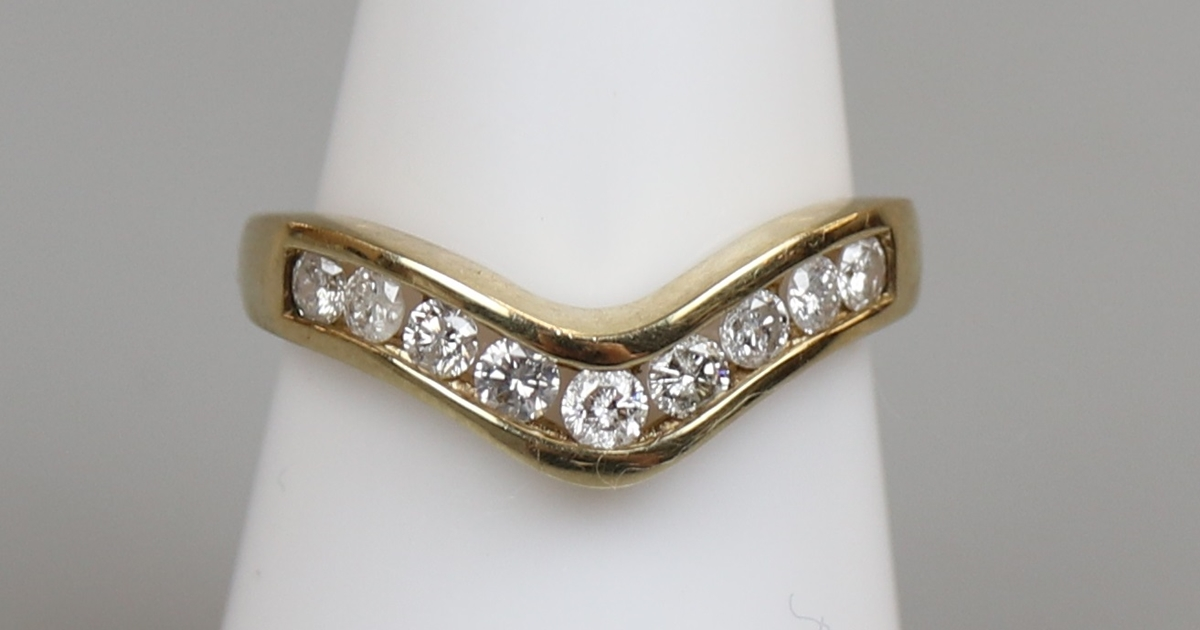 Gold channel set diamond ring ( approx ½ct total)