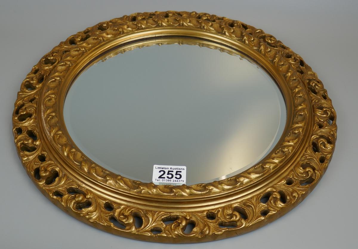 Round gilt framed mirror