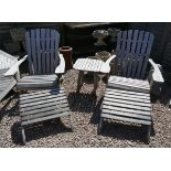 Pair of teak loungers with leg rests and table