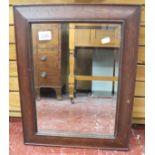 Small oak framed bevelled glass mirror