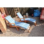 Pair of reclining teak steamer chairs with cushions - As new