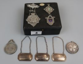 Collection of silver & white metal to include decanter labels