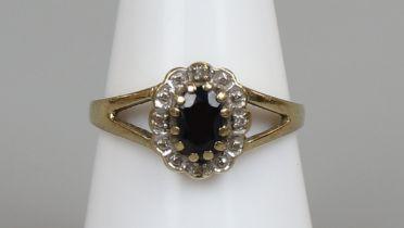 Gold diamond & sapphire cluster ring