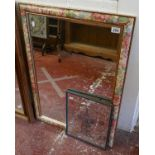Mirror in floral frame together with an advertising mirror