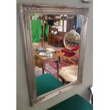 Bevelled glass mirror in silver frame