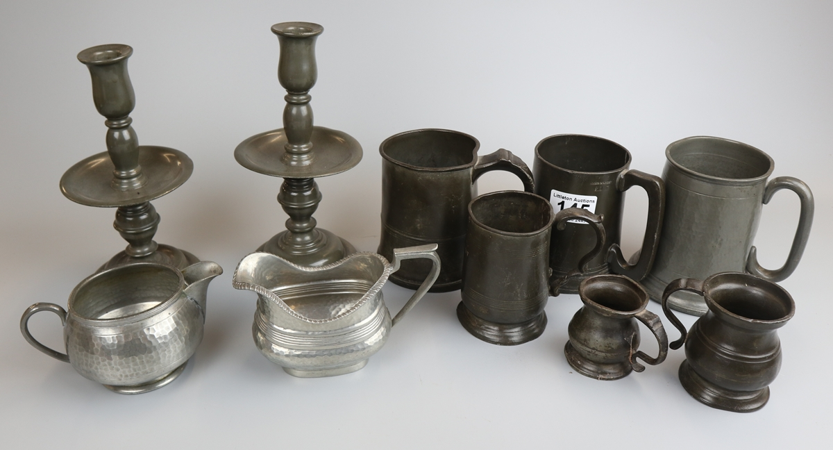 Collection of pewter to include tankards & candlesticks
