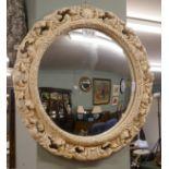 Convex mirror in ornate frame