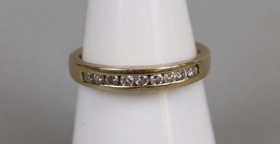 Gold channel set diamond ring - Size N