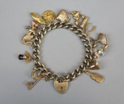 Gold plated charm bracelet with gold charms