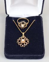 Gold pendant on chain with matching ring (size L)