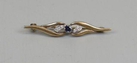 Gold brooch set with diamond & sapphire